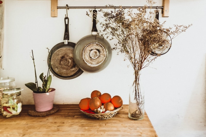 Pans hanging over counter along the kitchen wall