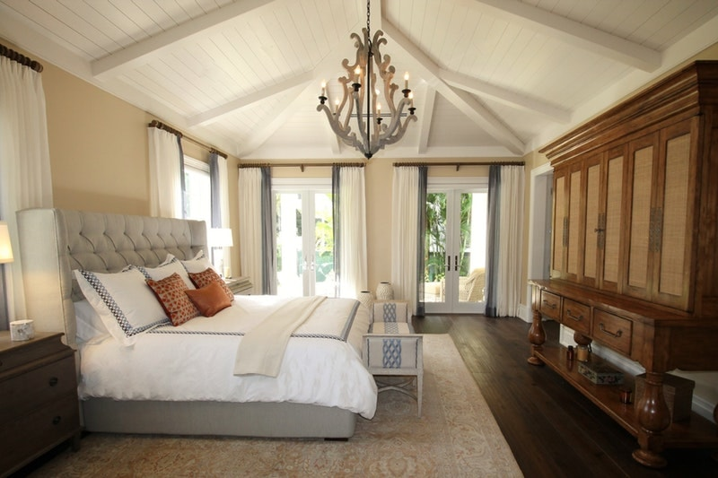 A bedroom with a slanted ceiling and complications