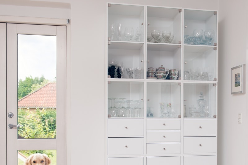 A room with A room with a pair of french doors next to a cabinet