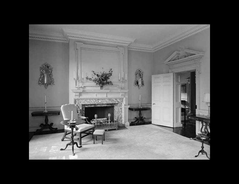 A black and white photo of a room that uses Georgian molding