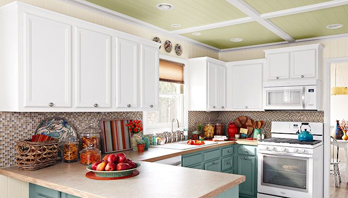 A bright kitchen with crown molding running along the top of the cabinets