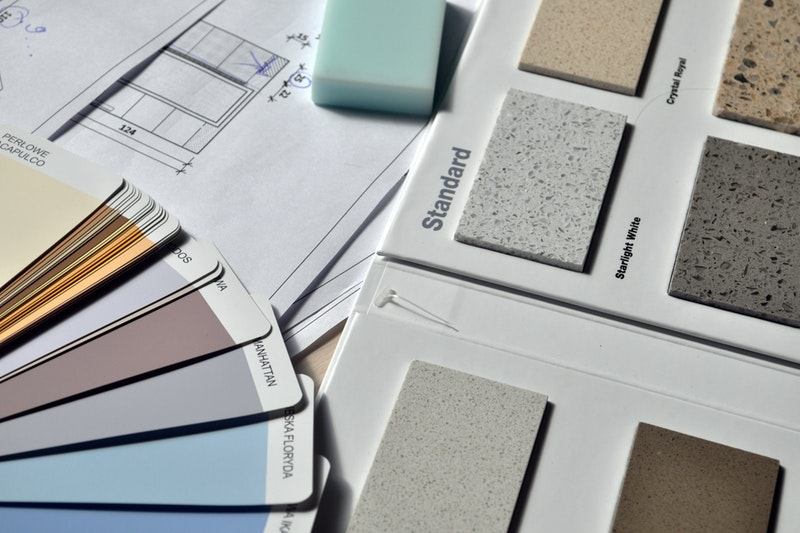 Paint swatches next to tile samples and floor plans