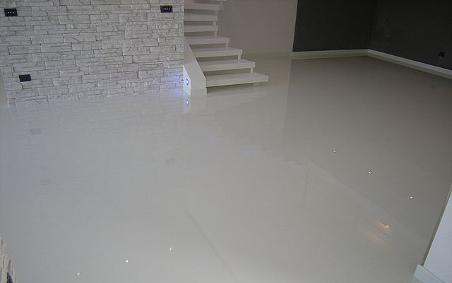 A basement floor coated in white epoxy