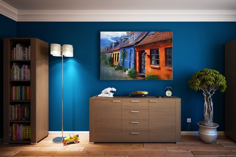 A painted basement room with rich, blue walls