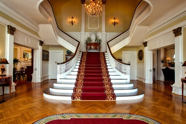 A large staircase in a home with a high ceiling