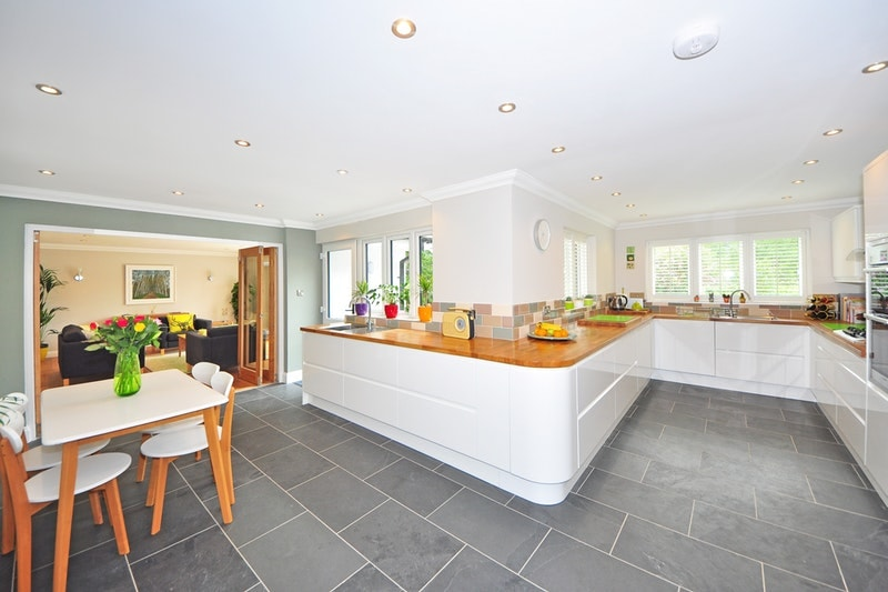 A bright kitchen with tiled flooring