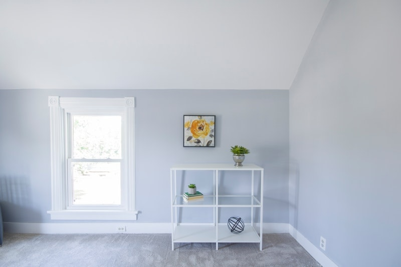 A room with a white ceiling and blue walls