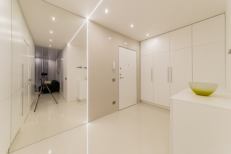 A bright room with a white flushed door in the corner