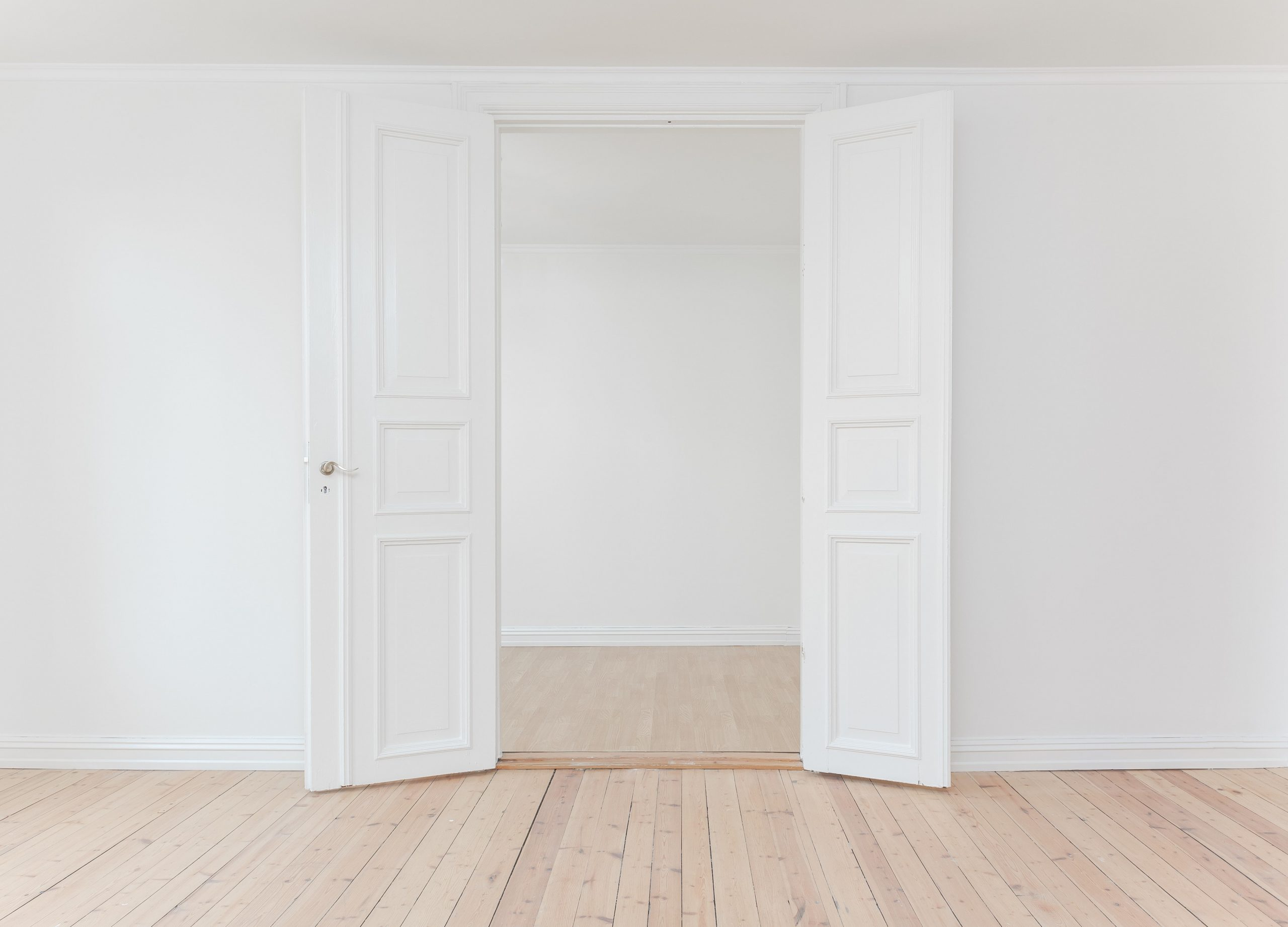 A simple white room with wooden crown molding