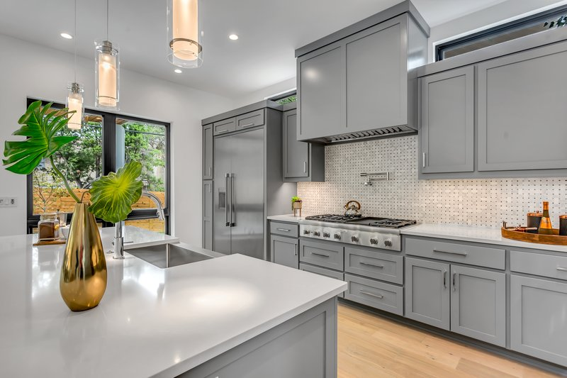 A bright kitchen with grey cabinets and interior