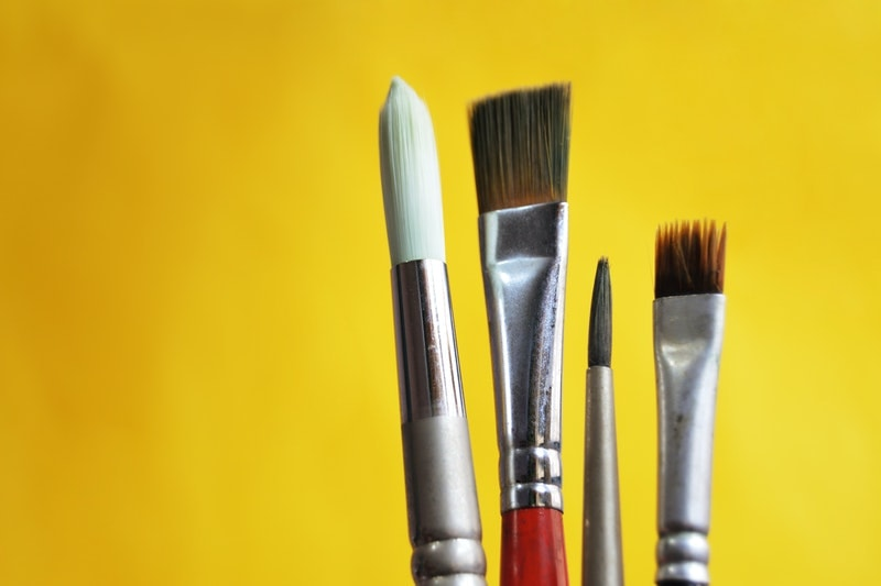 A closeup of four artist's brushes