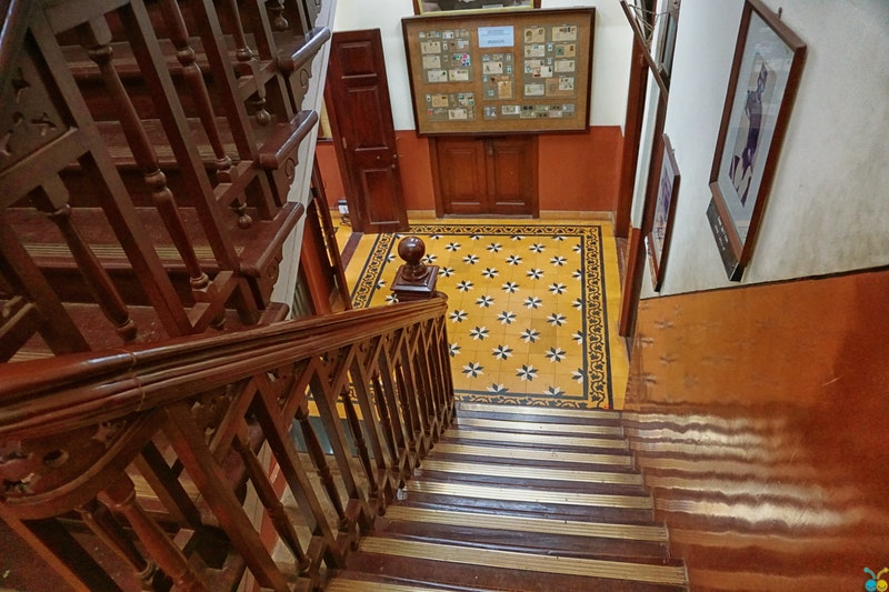 A beautifully-stained staircase lined with spindles