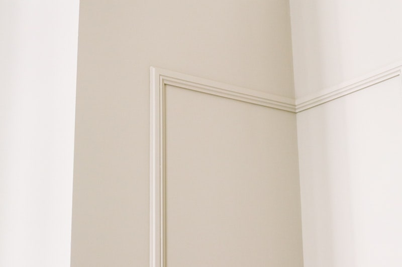 A closeup of the corner and edges of a room with a smooth finish
