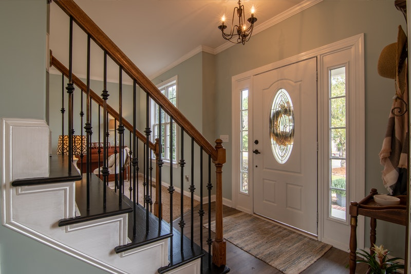 An entryway with a beautifully painted front door