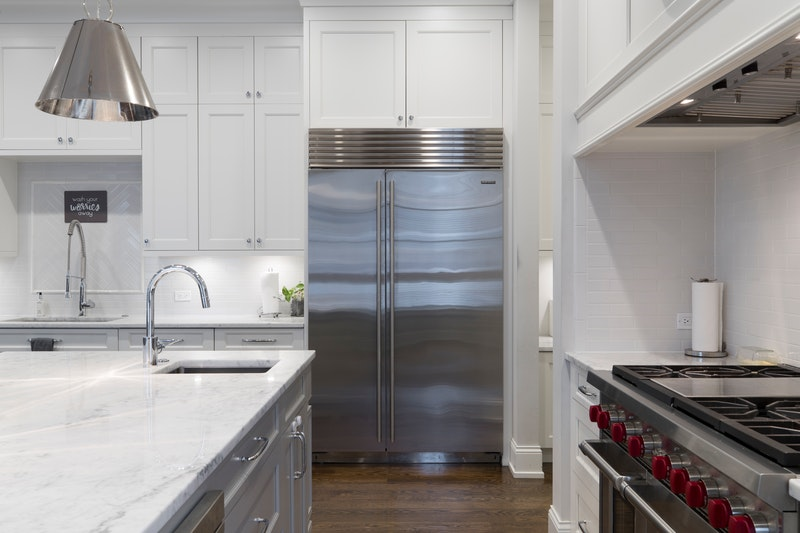 A kitchen with beautiful, white cabinets