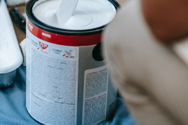 A closeup of a can of primer in use